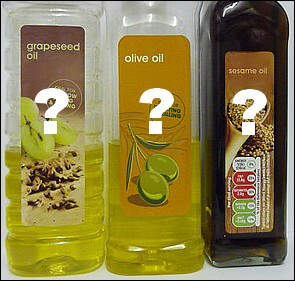 Grapeseed oil, olive oil and sesame oil bottles