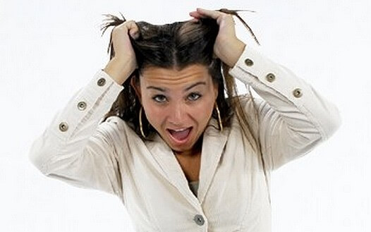 Lady looking stressed pulling at her hair