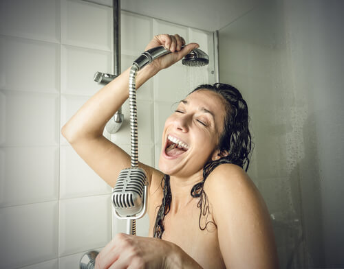 Lady rinsing hair and singing in the shower